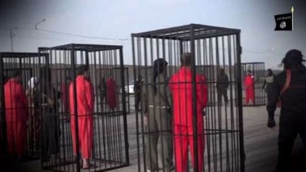 ISIS Prisoners dressed and caged as GITMO prisoners are
